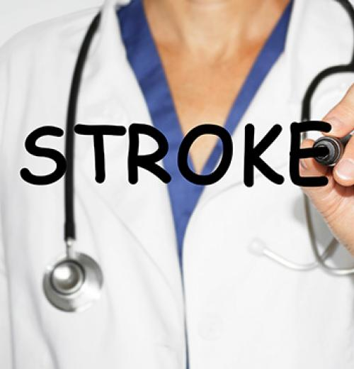 doctor writing the word stroke with marker