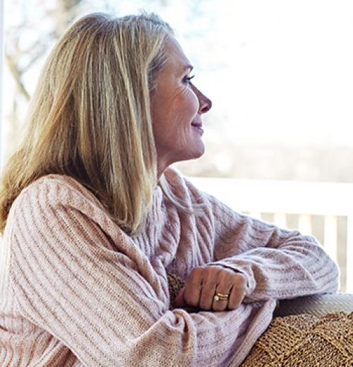 woman smiling looking out of window